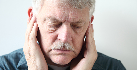 Stock image of a man with TMJ