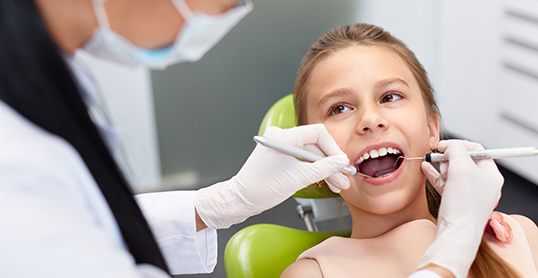 Stock image of young girl at the dentist